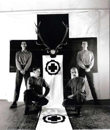 Laibach band with NSK cross